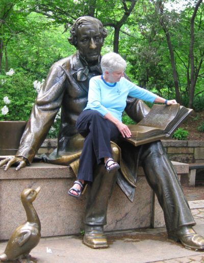 5a. Connie takes a reading break with Hans Christian Anderson in Central Park