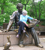 5b. Connie takes a reading break with Hans Christian Anderson in Central Park